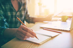 Hand with pencil and notebook Royalty Free Stock Image