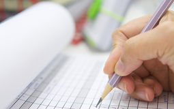 Hand with pencil over checklist form Royalty Free Stock Image