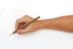 Hand with pencil over white background. Male hand with red pencil over white background Stock Photography