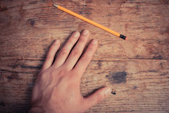 Hand and pencil Stock Photo