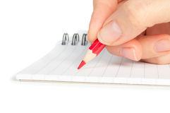 Hand with pencil writing on notebook Stock Images
