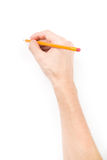 Hand with pencil writing something. Isolated on white background with shadows stock photo