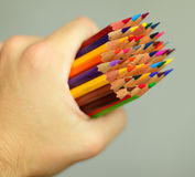 Hand with pencils Stock Images