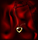 Hand and pendant heart Royalty Free Stock Image