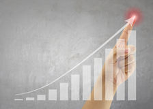 Hand of people point to highest bar graph. Hand of people point to highest bar graph for Presentation and publicity to promote your business stock images