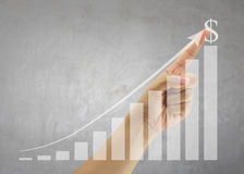 Hand of people point to highest bar graph. Hand of people point to highest bar graph for Presentation and publicity to promote your business royalty free stock photos