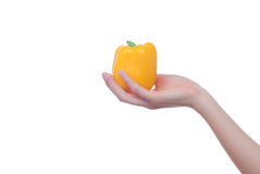 Hand with pepper isolated on white royalty free stock photos