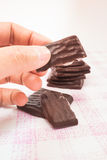 Hand on peppermint chocolate piece Royalty Free Stock Images