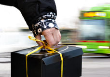 Hand of person carrying black box Royalty Free Stock Images