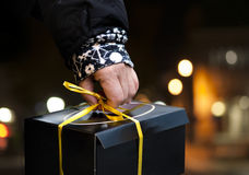 Hand of person carrying black box Royalty Free Stock Photos