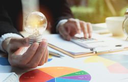 Hand of person holding light bulb for idea and success. Innovation and creative concept. stock images