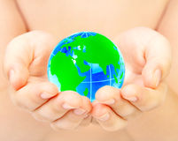 Hand of the person holds globe Stock Image