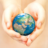 Hand of the person holds globe. Royalty Free Stock Photo