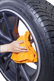 Hand person polishing car tires Stock Photo
