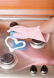 Hand of the person in a rubber glove cleans Stock Image