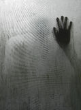 Hand person shadow behind translucent mirror Royalty Free Stock Images