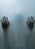 Hand person shadow behind translucent mirror Stock Photos