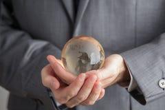 Hand Person Very Gently Holds Globuss Lizenzfreie Stockfotos
