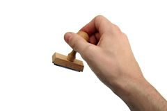 Hand of person with wood stamp Royalty Free Stock Photos