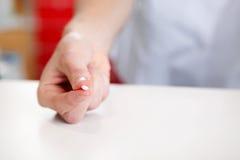 Hand Of Pharmacist Holding Medicine Pill Stock Photos