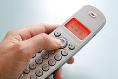 Hand phone dialing Stock Images