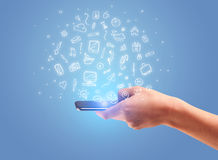 Hand with phone and drawn office icons Stock Photo