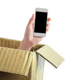 Hand with phone out of box Stock Photos