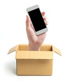 Hand with phone out of box Royalty Free Stock Photos