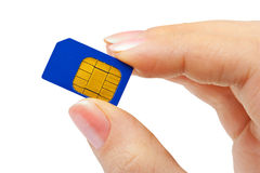 Hand and phone sim card Royalty Free Stock Images