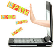 Hand from the phone stops spam word Stock Image