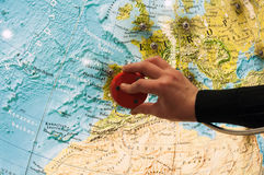 Hand with phonendoscope listens to the sounds of the earth on  large globe Stock Photography