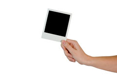 Hand with photo Royalty Free Stock Images