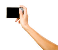 A hand with photo camera. Isolated hand with photo camera on white background royalty free stock photos