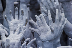 Hand. This photo are stucco hand to ask them to help haul up from hell Royalty Free Stock Image