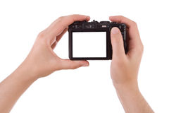 Hand photographing with a digital camera. Isolated on white Stock Photos
