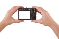 Hand photographing with a digital camera. Isolated on white Royalty Free Stock Photo