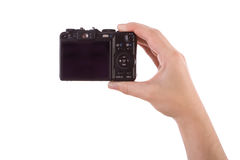 Hand photographing with a digital camera isolated Royalty Free Stock Images