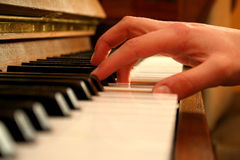 Hand on piano Royalty Free Stock Photography