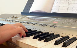 Hand with piano keyboard Royalty Free Stock Photography