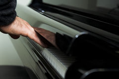 Hand on piano keyboard stock image