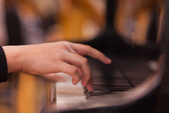 Hand on piano keyboard Royalty Free Stock Photo