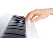 Hand and piano keyboard Royalty Free Stock Images