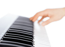 Hand and piano keyboard Stock Image