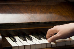Hand on Piano Keys. One hand playing a piano Royalty Free Stock Photo