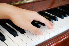 A hand on a piano Stock Images