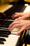 Hand of a piano player. Hand of a pianist playing on a piano Royalty Free Stock Image