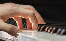 Hand of a piano player Royalty Free Stock Images