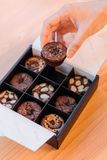Hand pick Brownie cupcake that topping with various ingredients such as almond, caramel and chocolate chips Stock Images