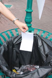 Hand pick the garbage put into bins. Stock Photography