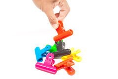 Hand pick up colorful plastic clip Royalty Free Stock Photos